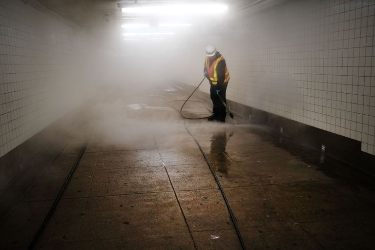 A worker cleaning a subway station