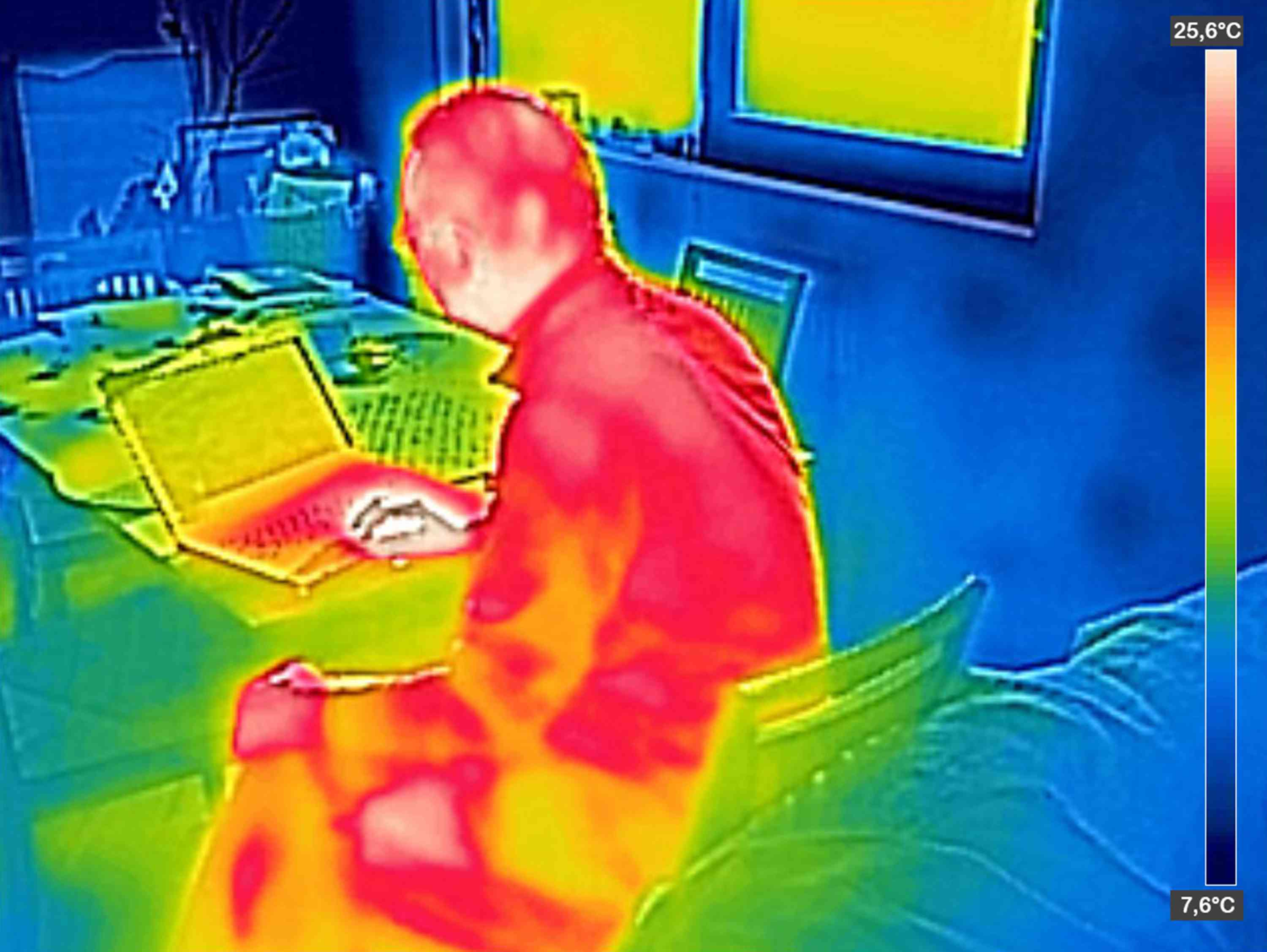 thermal infrared image of person using laptop computer
