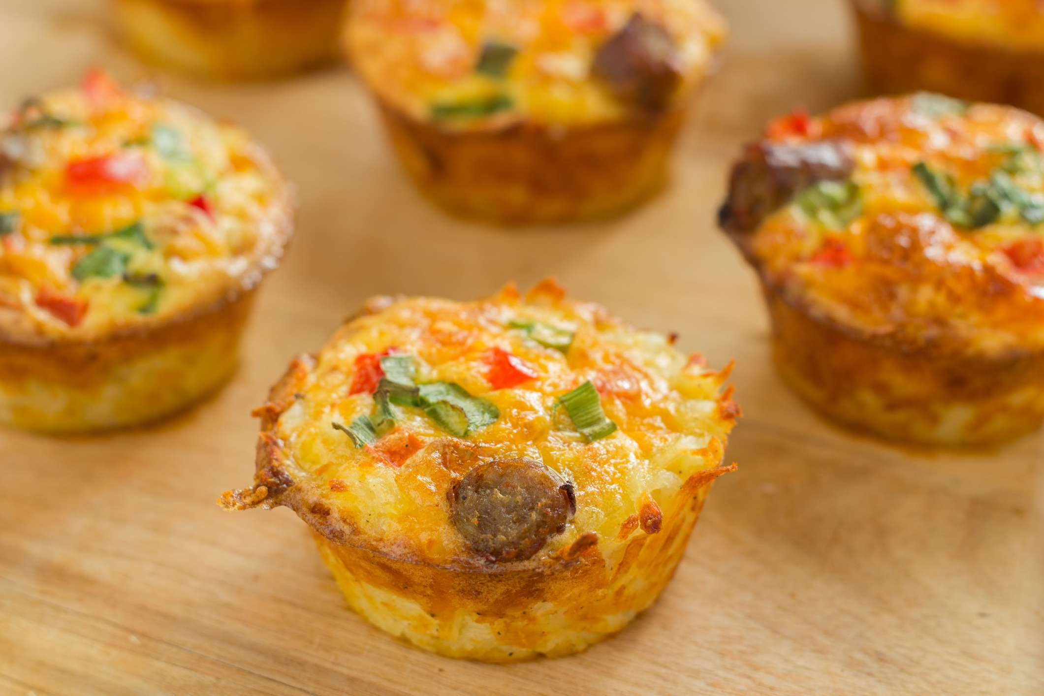 Egg muffins on a wooden cutting board