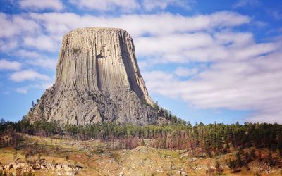Devils Tower on a partly cloudy day in Wyoming