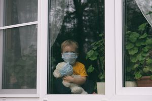 child and his teddy bear both in protective medical masks