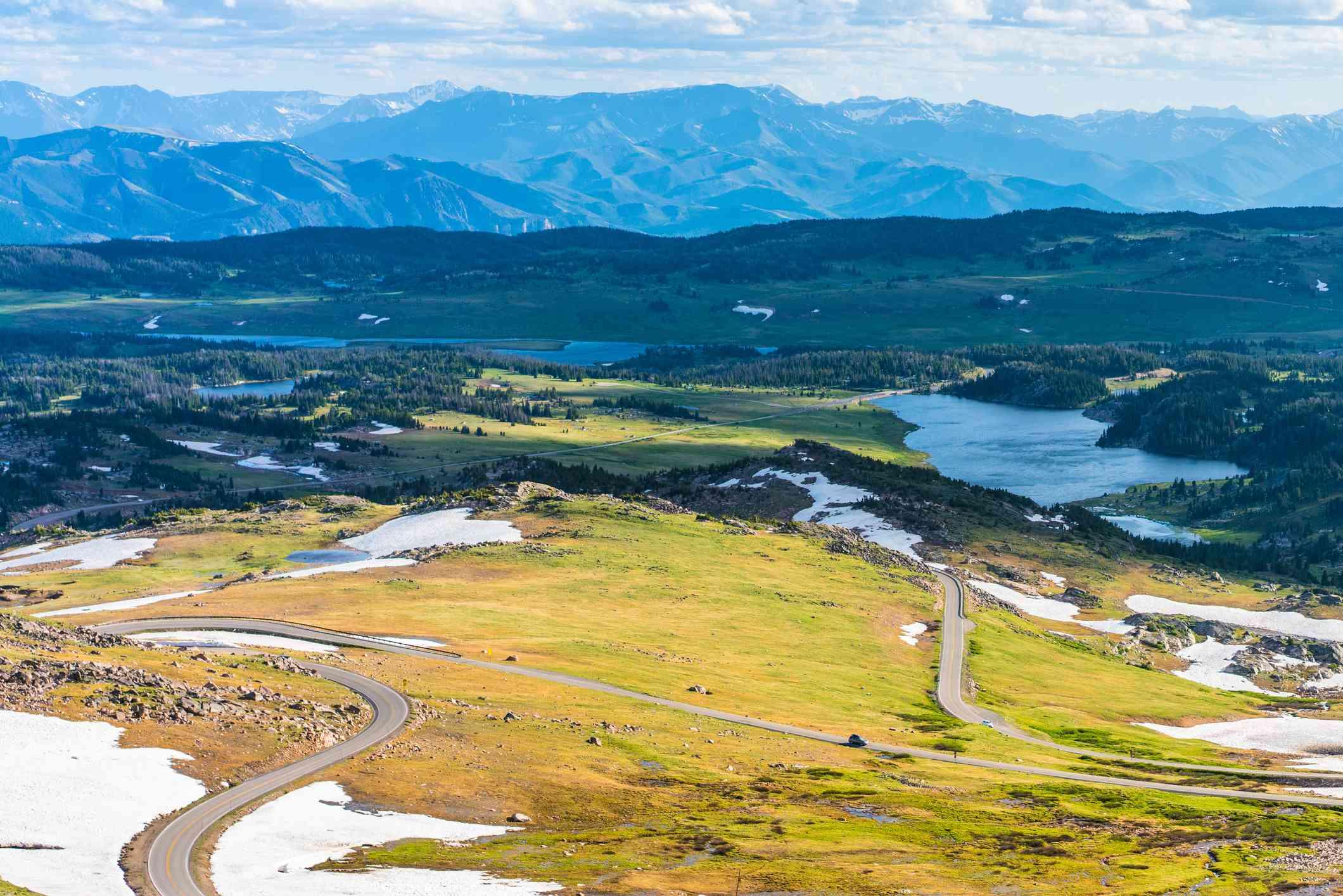 Beartooth Highway snaking through meadows, toward mountains