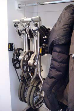 folding bike hanging in closet photo