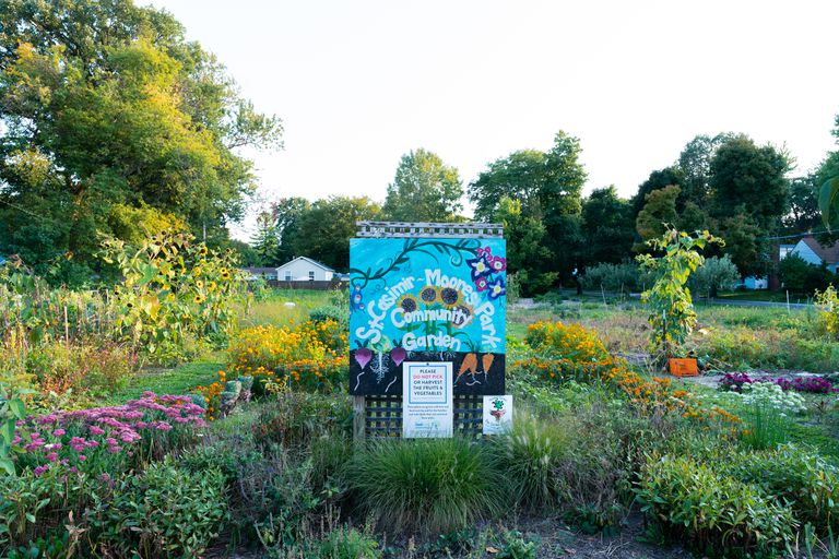 large community garden with handpainted sign