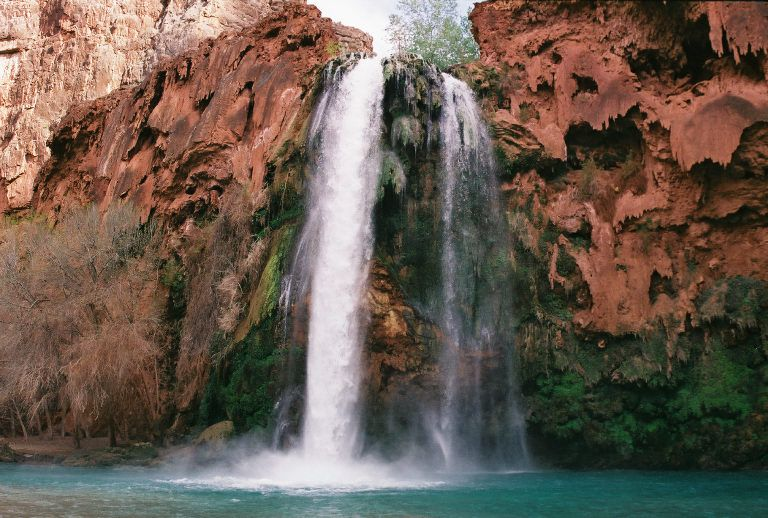 Waterfall pouring over a cliff formation