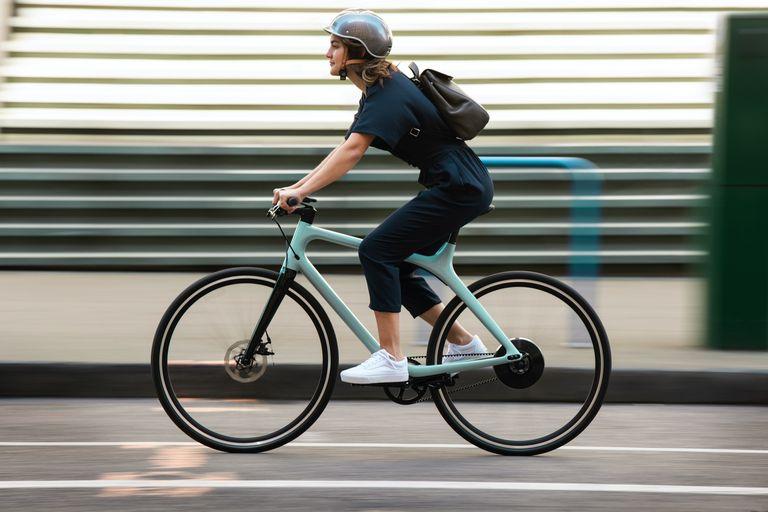 woman riding an aqua Gogoro bike