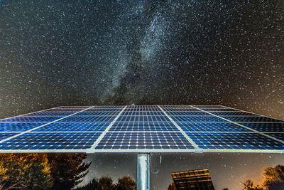 Solar panels under the night sky