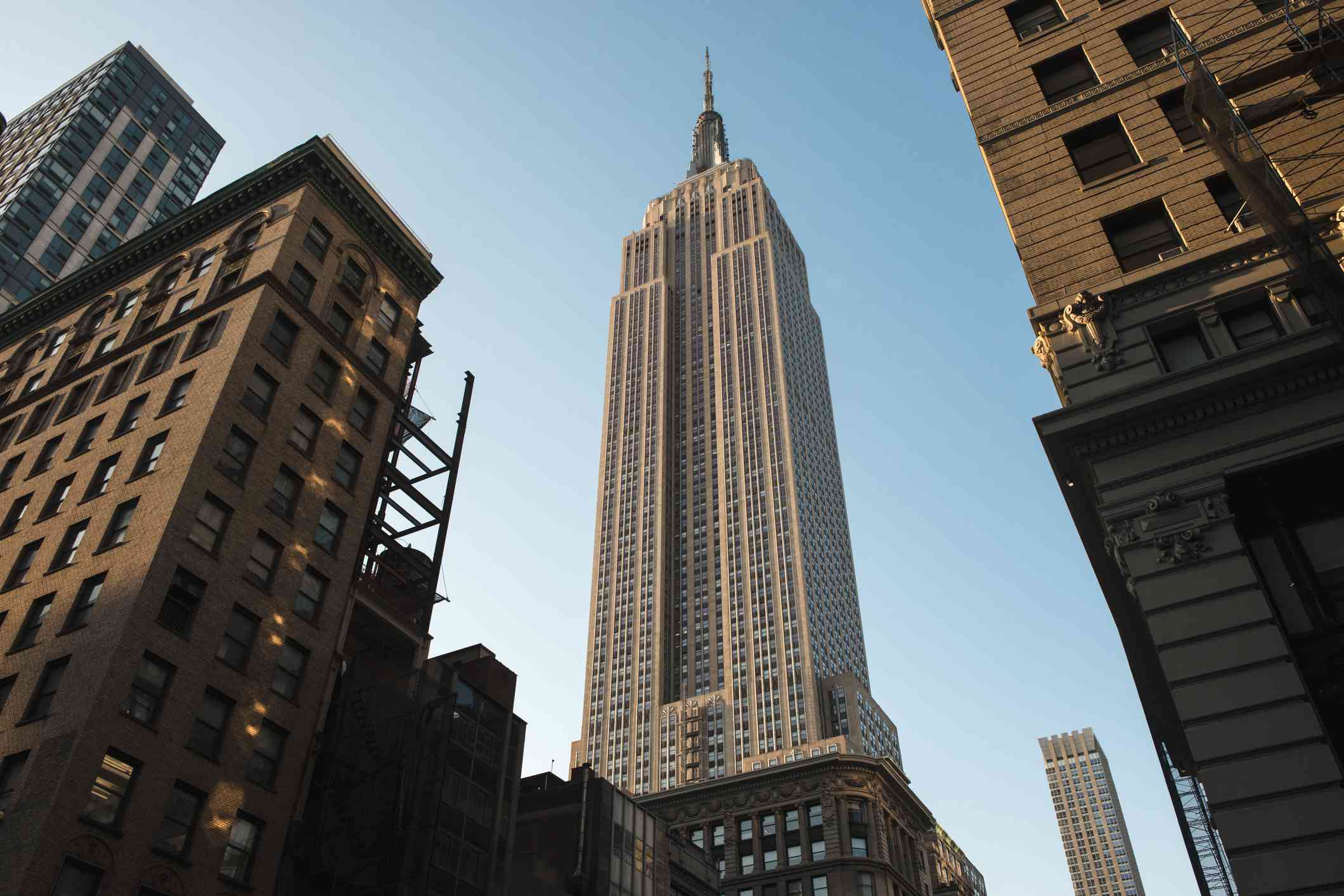 A shot of the Empire State Building from the ground.
