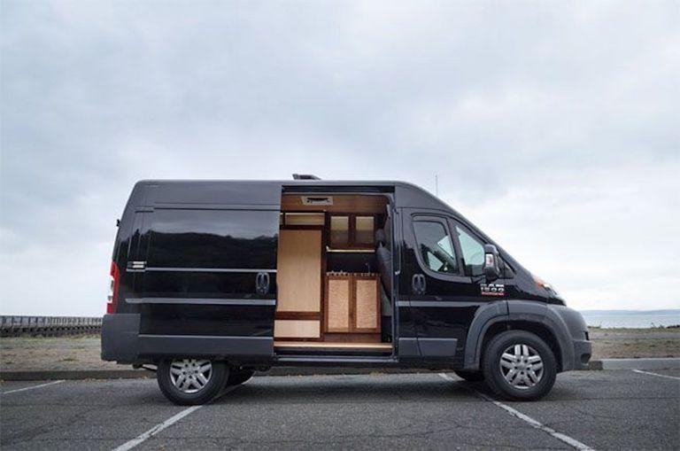Black van with side door open revealing living space