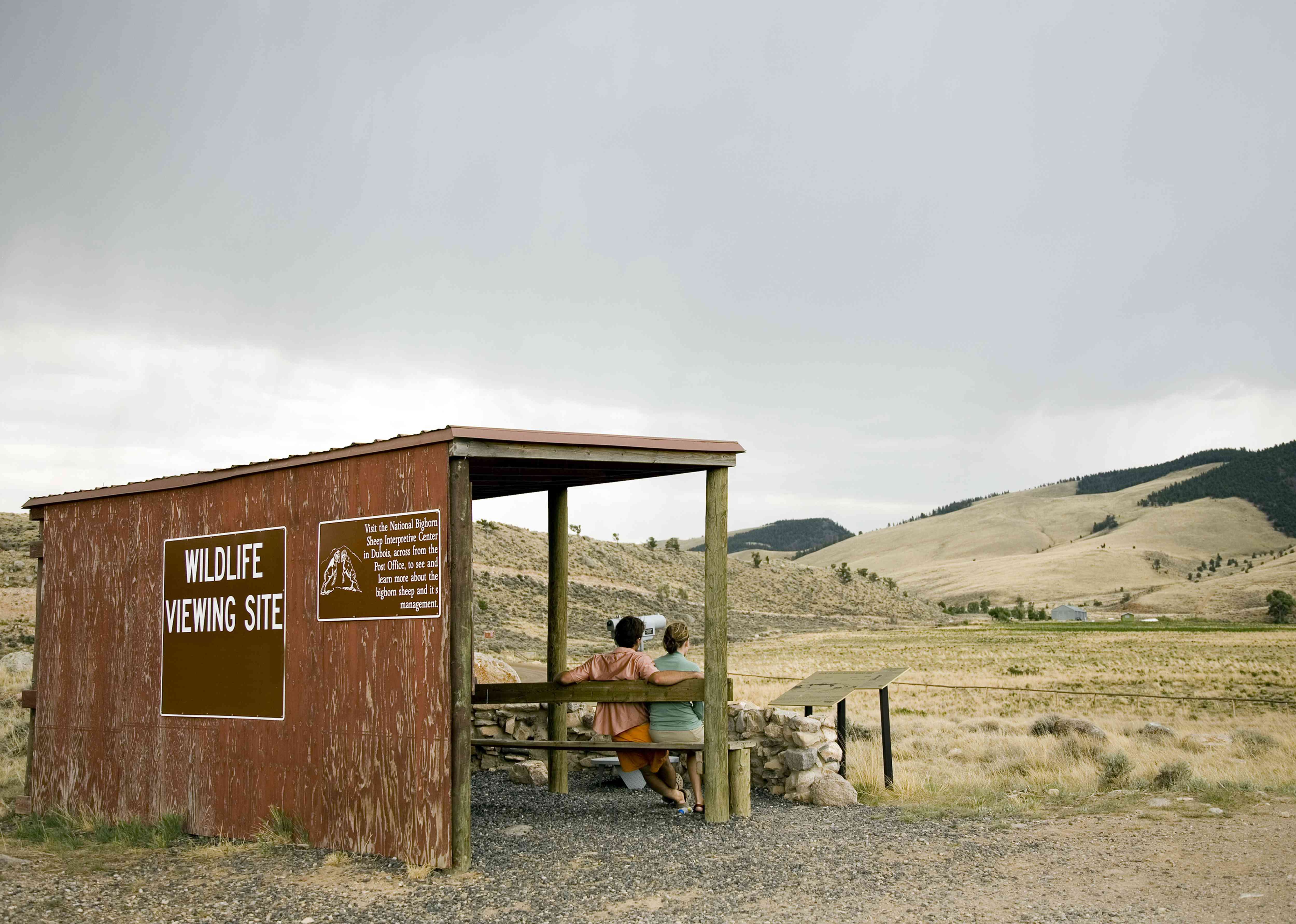 Couple sitting at National Bighorn Sheep Center wildlife viewing site