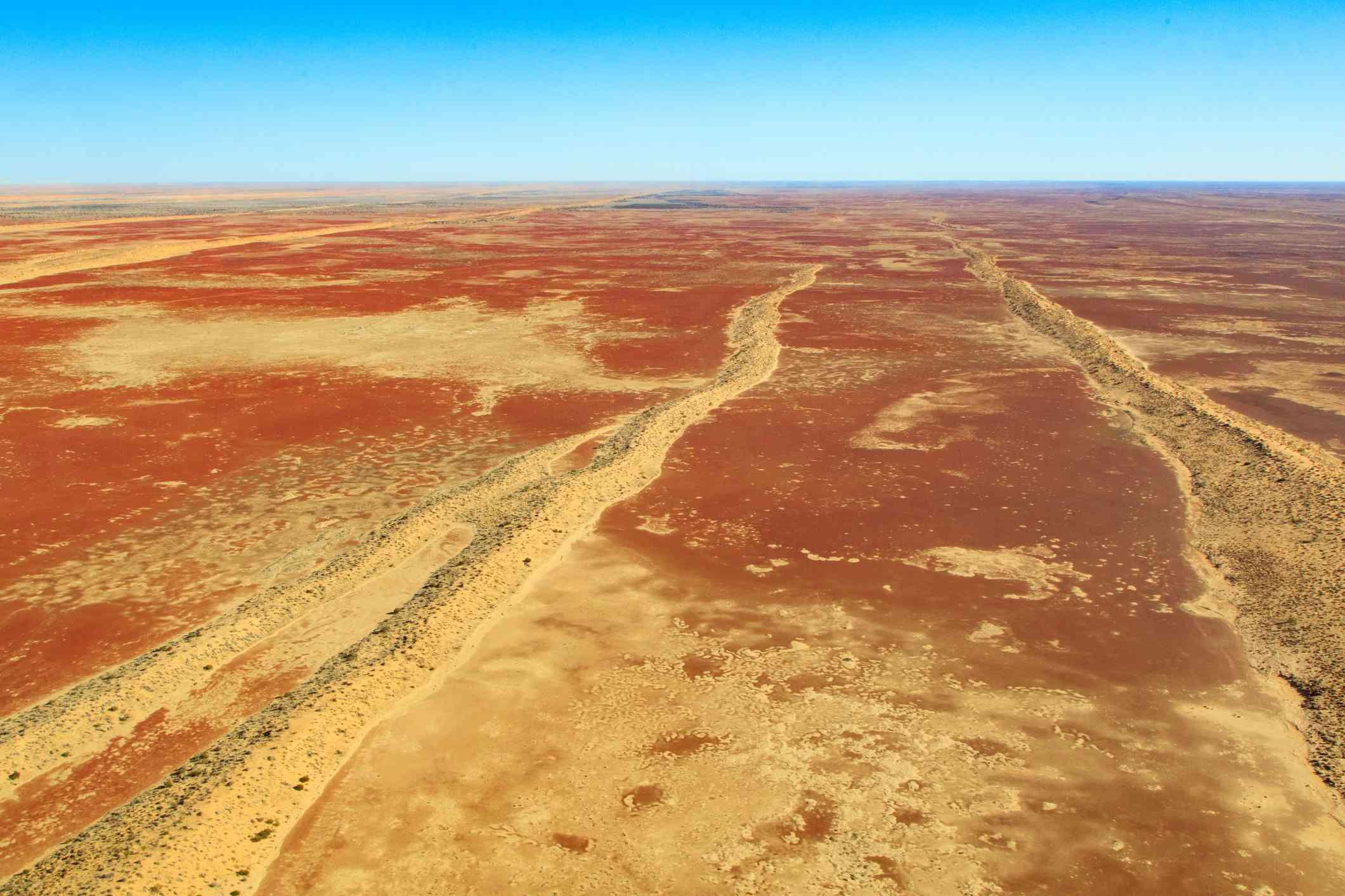 A desert in Queensland Australia against a blue sky.