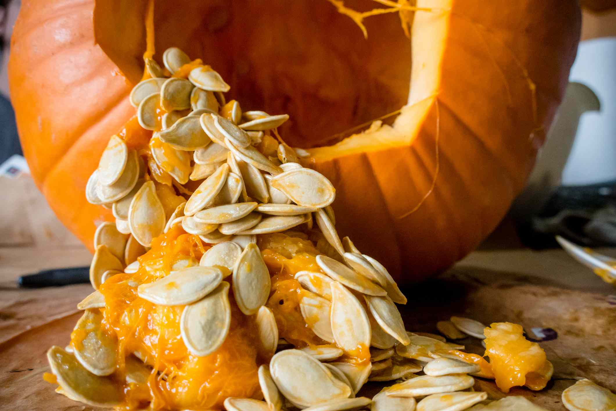 Pumpkin with seeds spilling out.