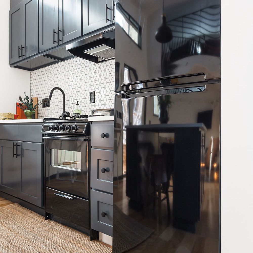 Close up of fridge and cabinets in the tiny home kitchen