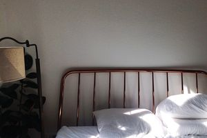 Sunlight Falling On Bed At Home