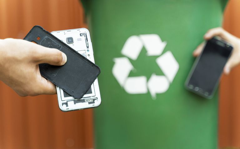 E waste ,disassembled smartphone and recycle bin