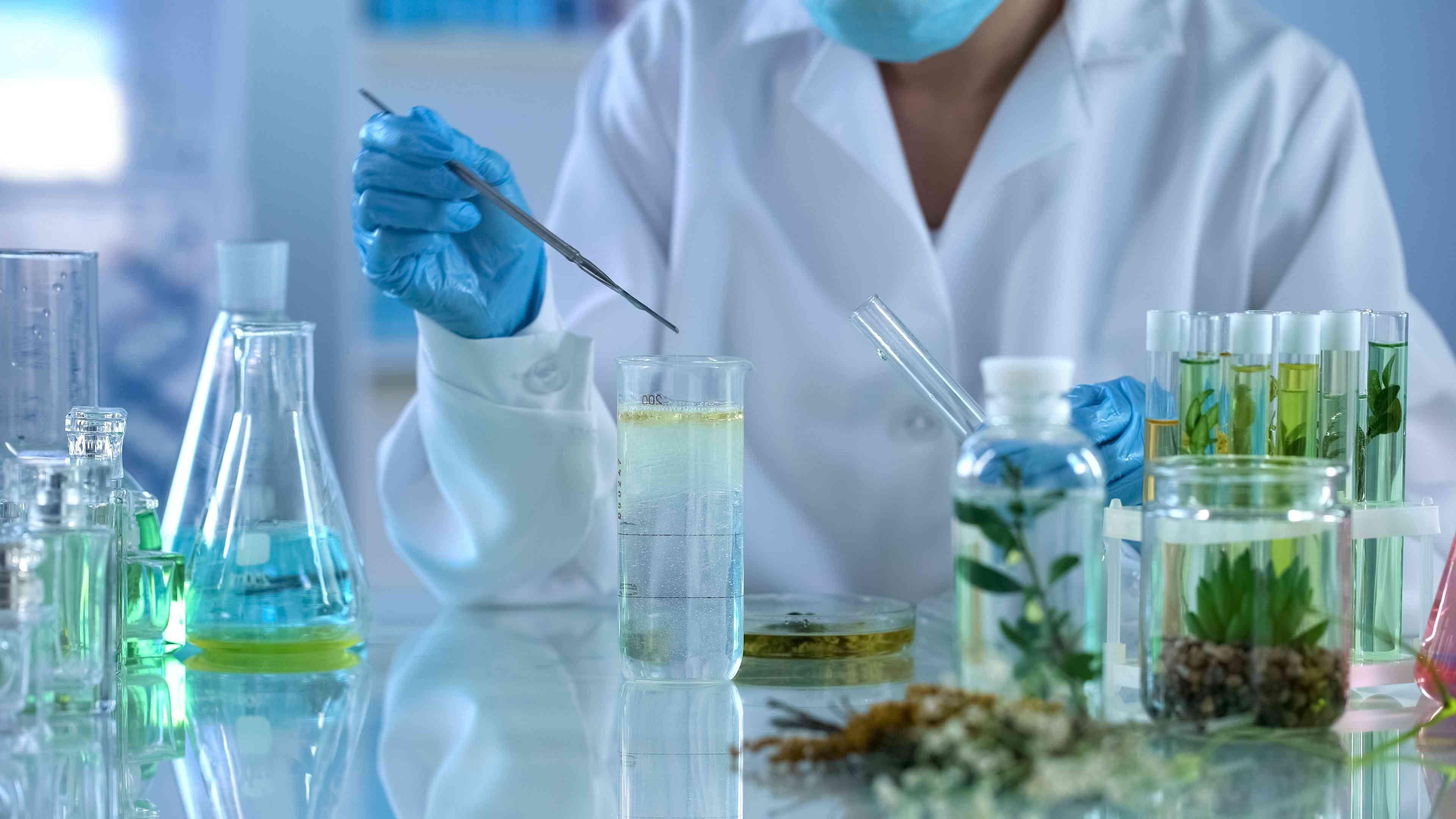 A scientist in a lab creating botanical formulas.