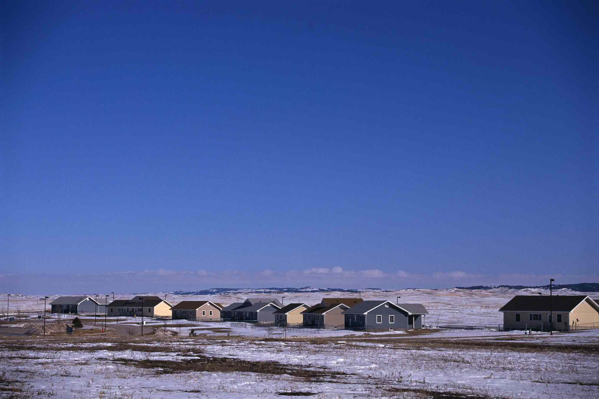 Houses and snowy, barren land on Pine Ridge Reservation