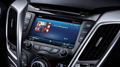 The Boss Cover Art on a Hyundai Veloster Dash Screen.