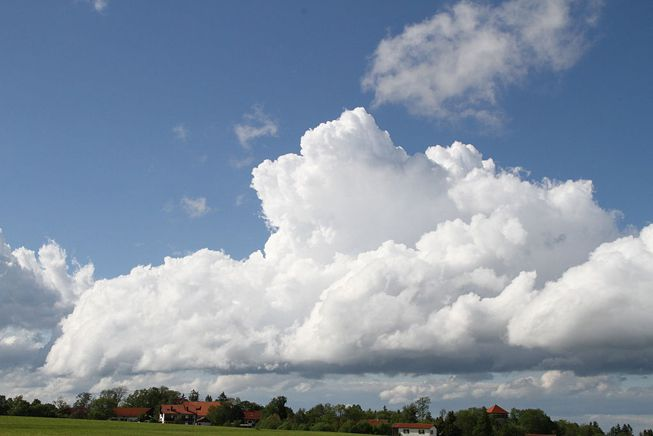 A cumulus congestus cloud over a town in Germany