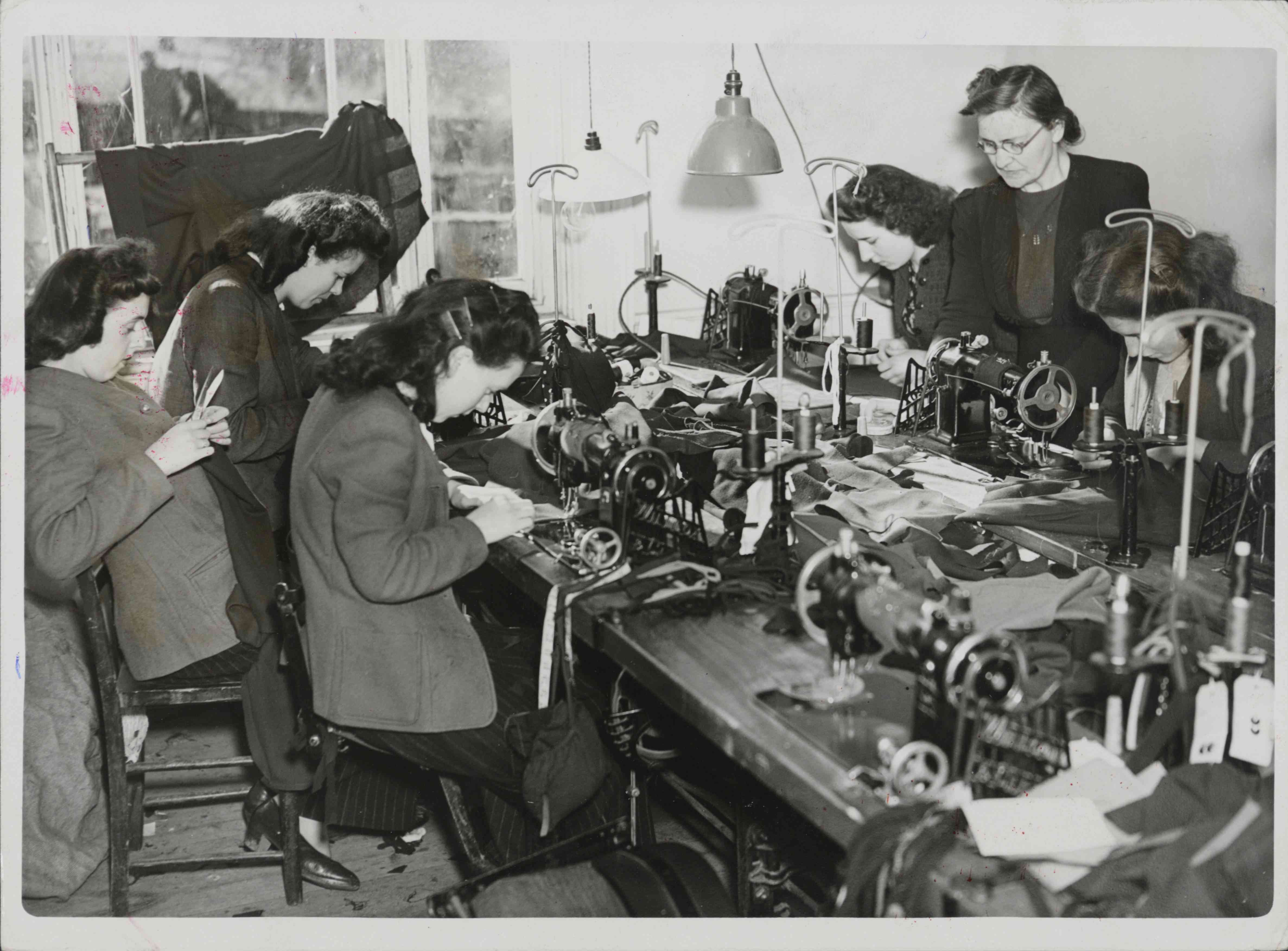 Women using electric sewing machines