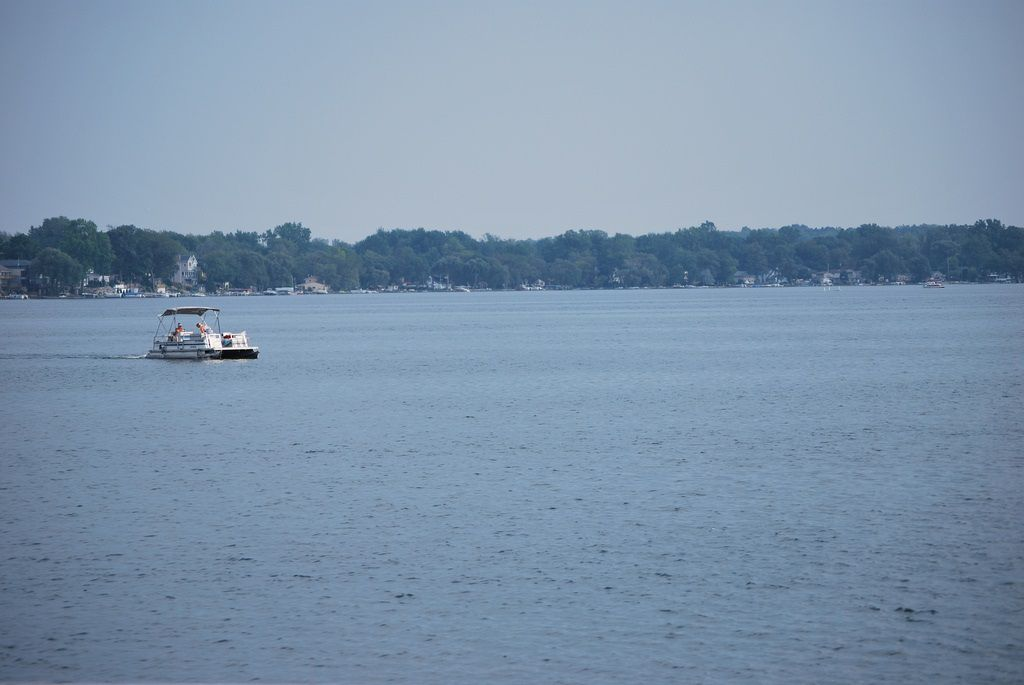 Walled Lake with one boat in the distance