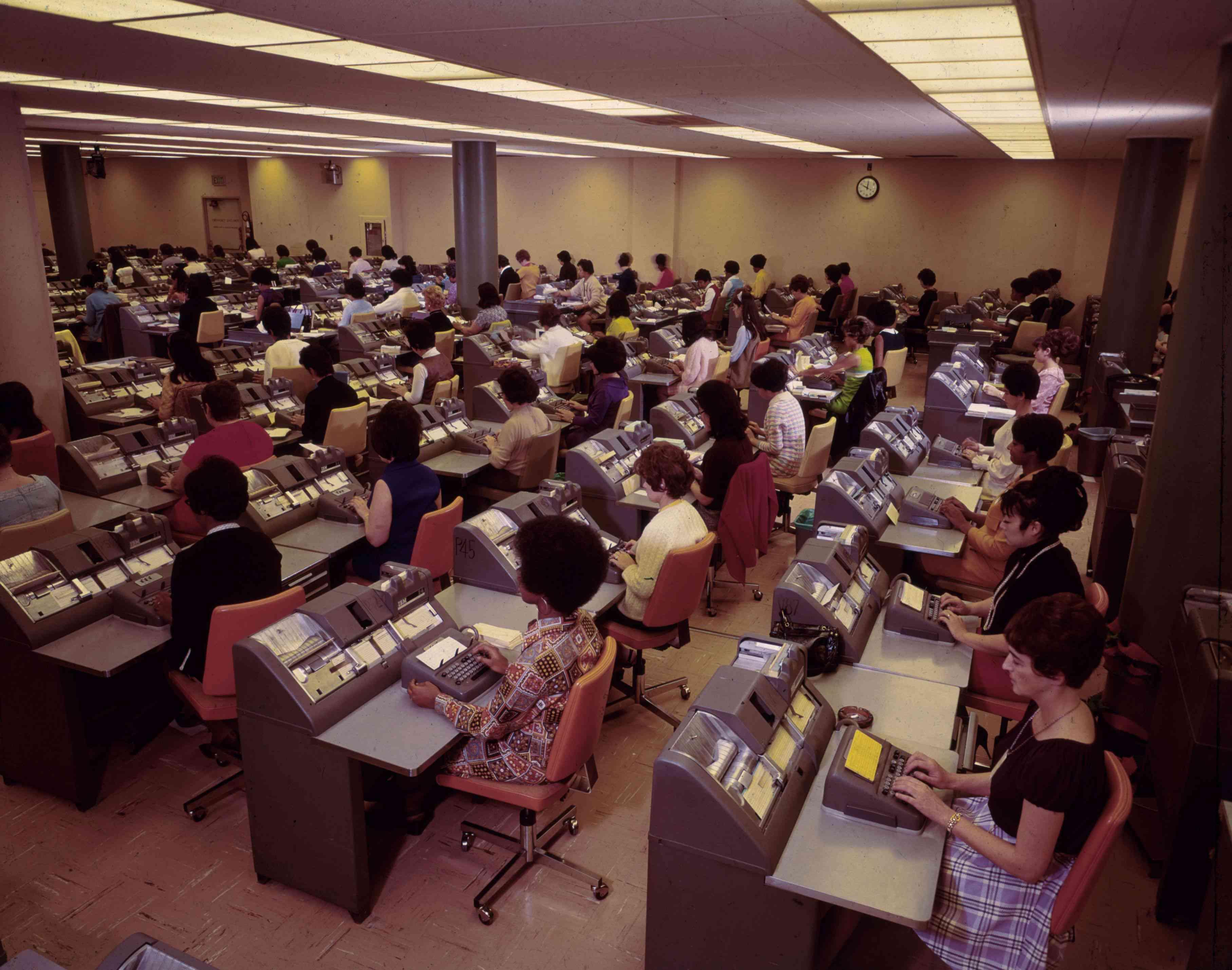 office workers in windowless room