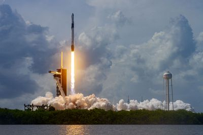 SpaceX rocket launching in a cloud of smoke and steam