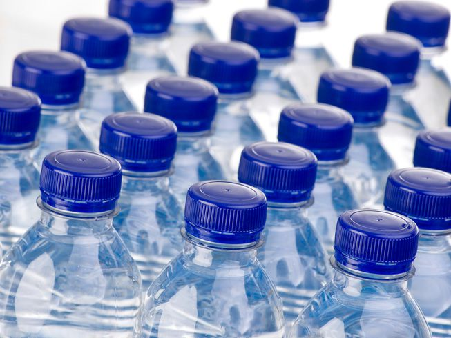 Bottles of water with blue caps