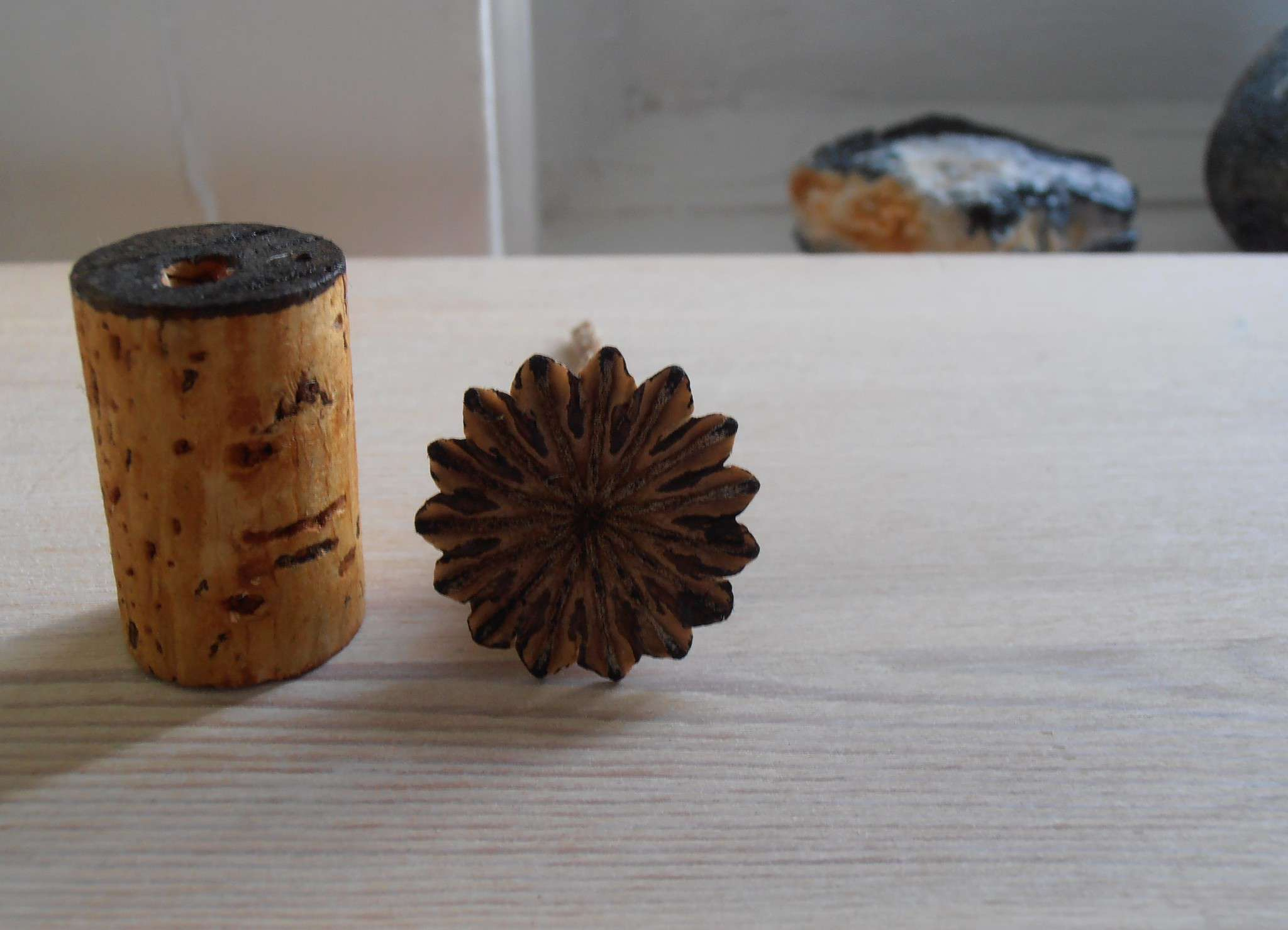 Stamps made from a wine cork and a dried flower