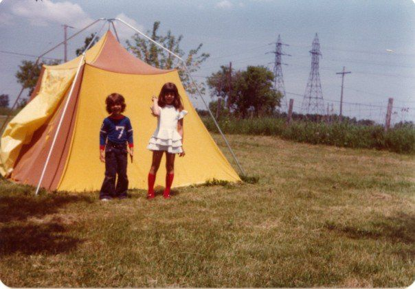 Kids standing in front of a tent