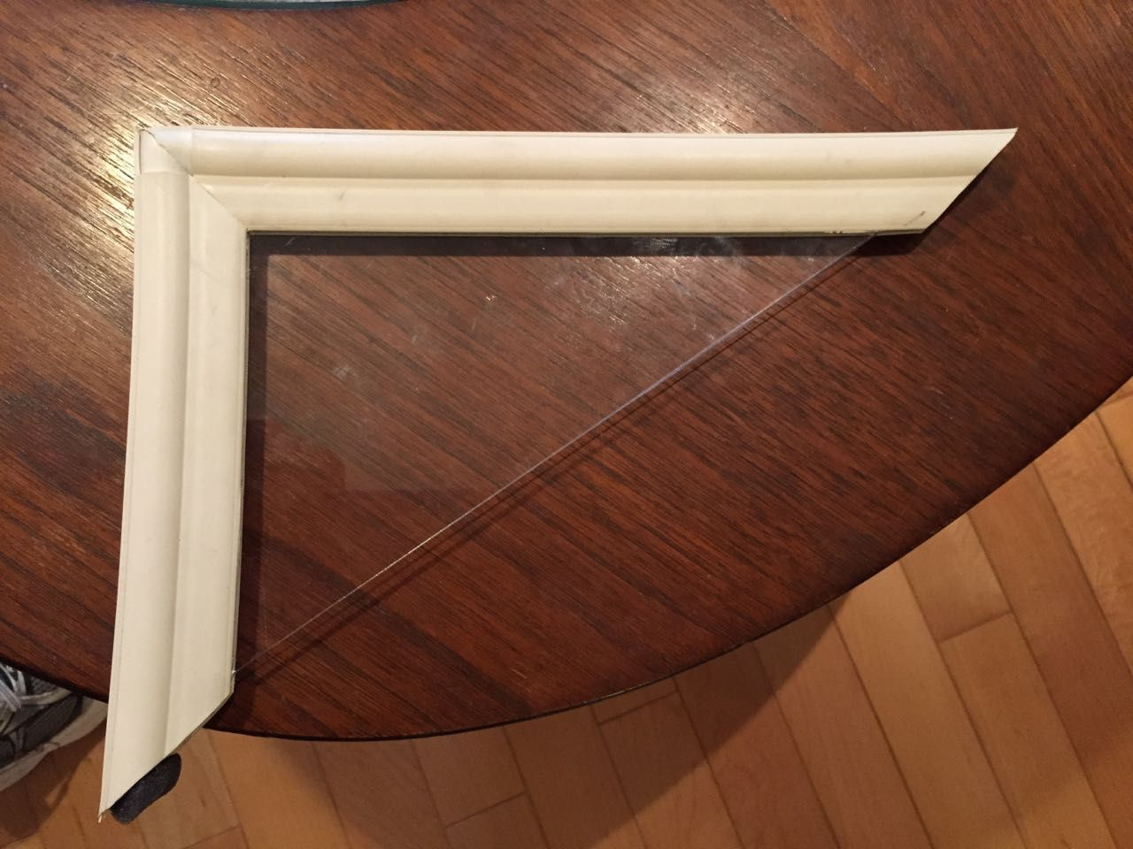 Section of window pane and frame sitting on a table