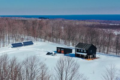 House in snow on Lake Huron