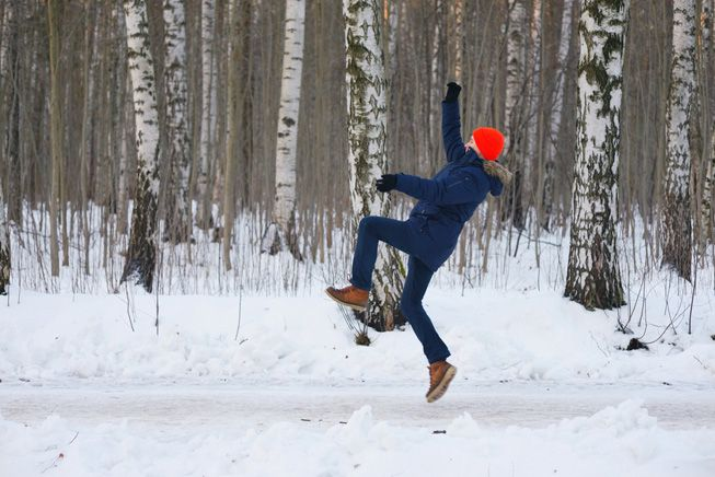 A man caught in mid-air while slipping on ice
