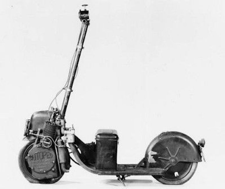 Black and white side view of an autoped scooter