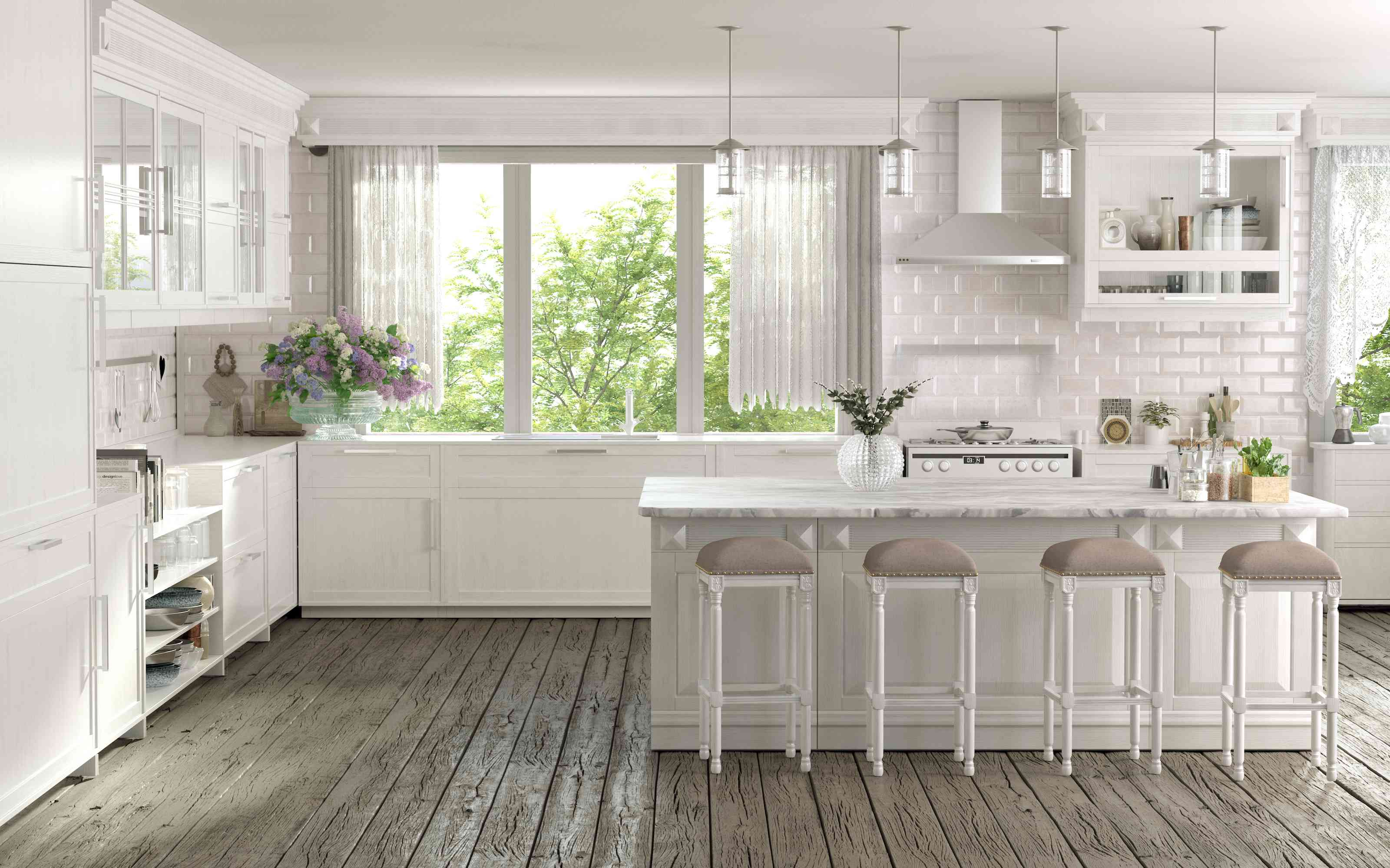 White kitchen with a center island and stools