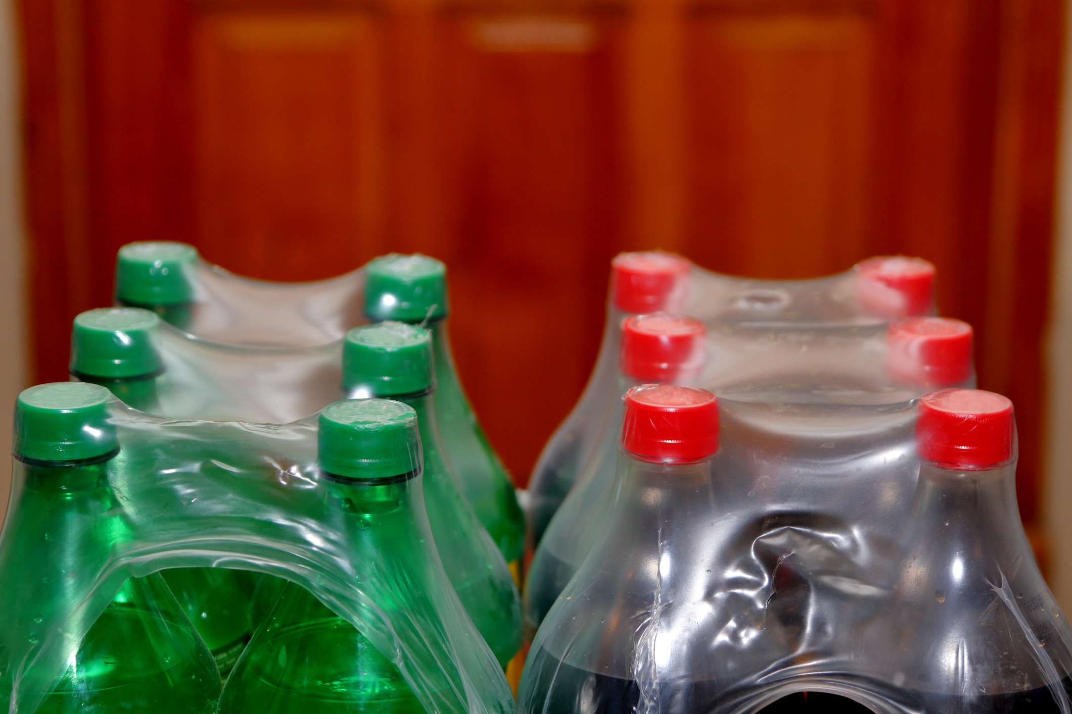 Soda in plastic bottles and packaging.