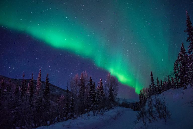 The Northern Lights over a snowy landscape