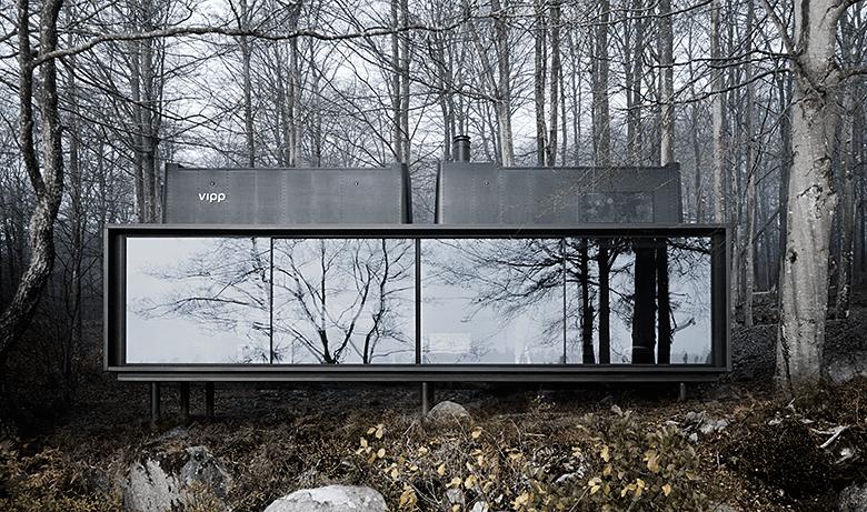 VIPP rectangular module among trees at a lake
