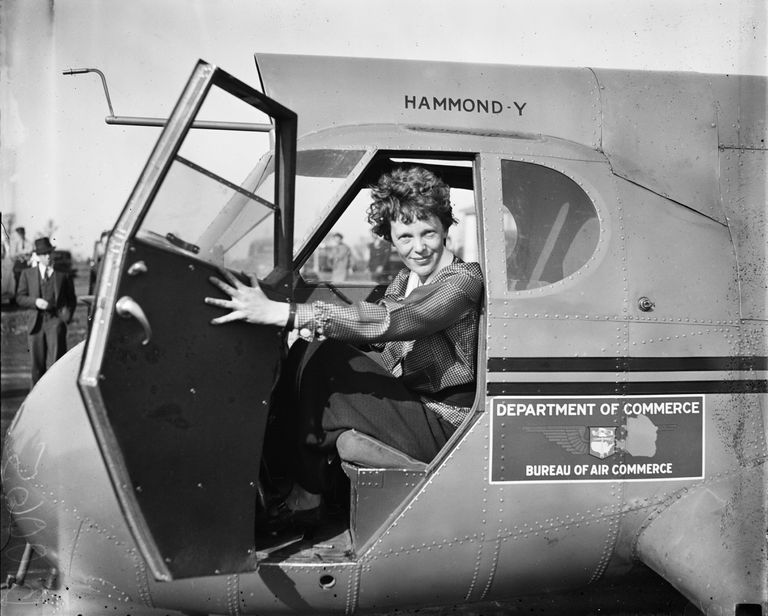 Amelia Earheart sitting in the cockpit of a plane