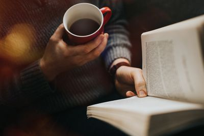 Reading a book with a cup of coffee