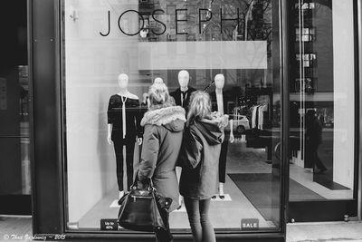 Two women window shopping