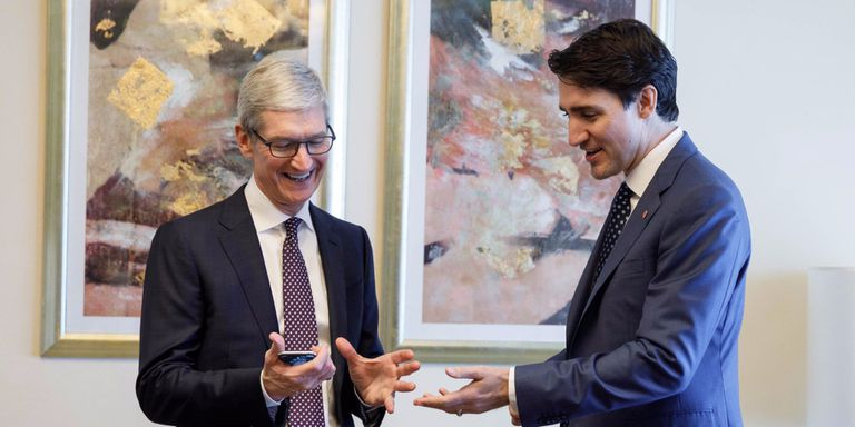 Tim Cook and Justin Trudeau admiring an iPhone 10 in December, 2017.