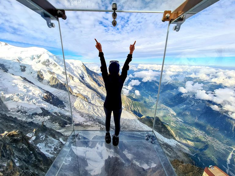 A woman looks out onto the French Alps from Step into the Void.