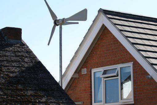 Wind turbine generator on house roof