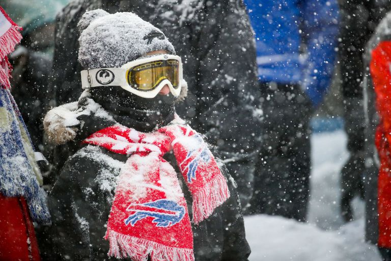 Buffalo Bills fan bundled up watching the game in the snow