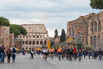 cyclists near the Colosseum in Rome