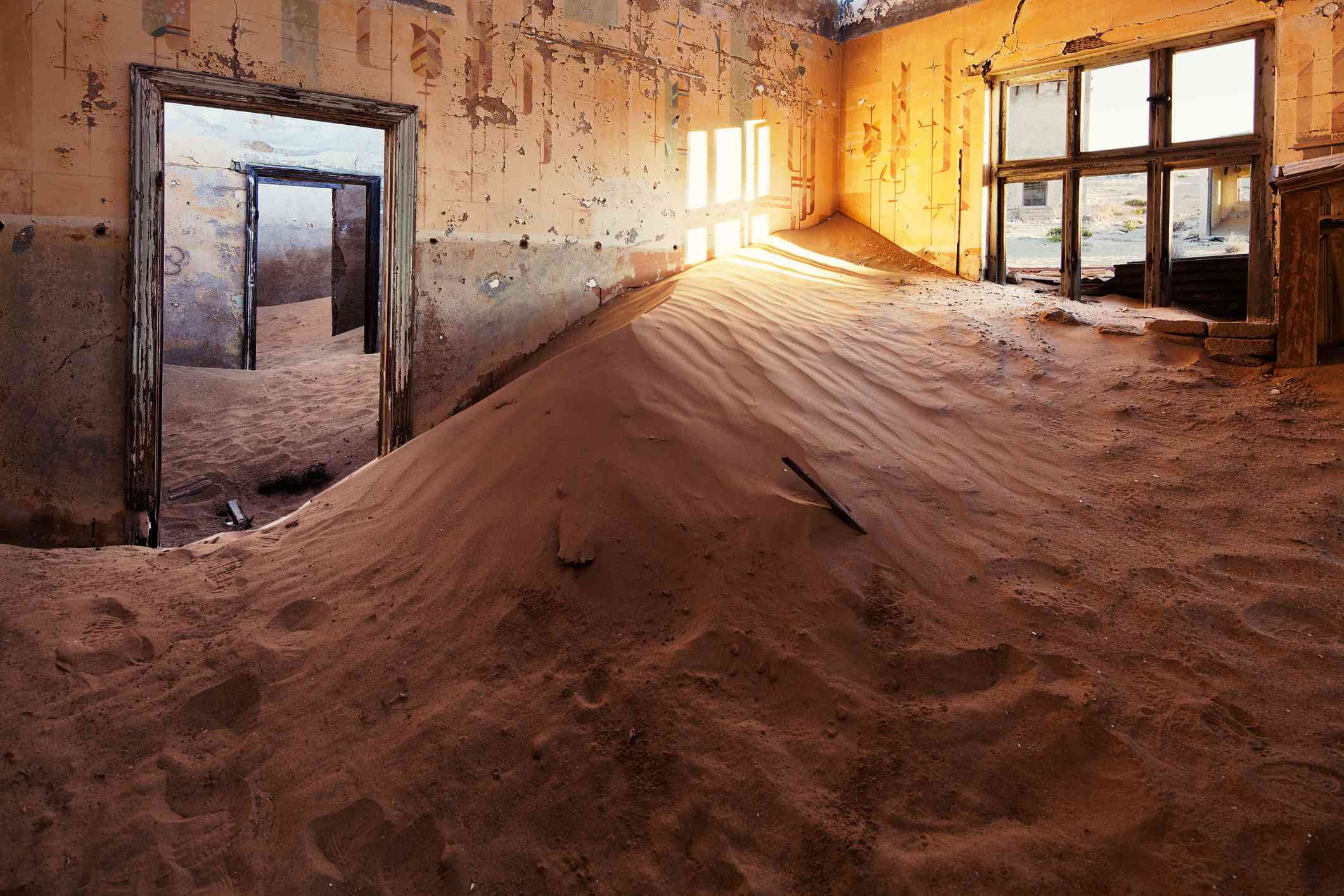 Sand-filled room in the abandoned town of Kolmanskop, Namibia