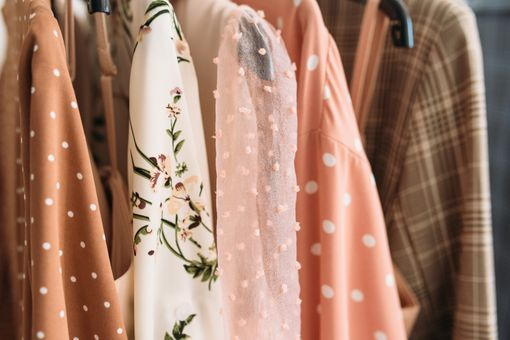 Capsule clothes in beige and pink colors closeup