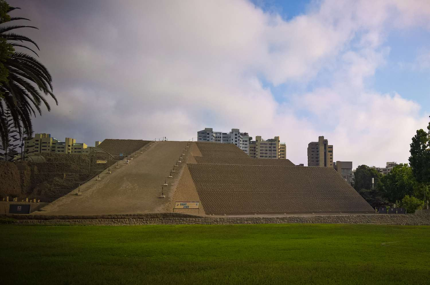 Huaca Huallamarca in Lima, Peru with modern high-rise buildings in the background