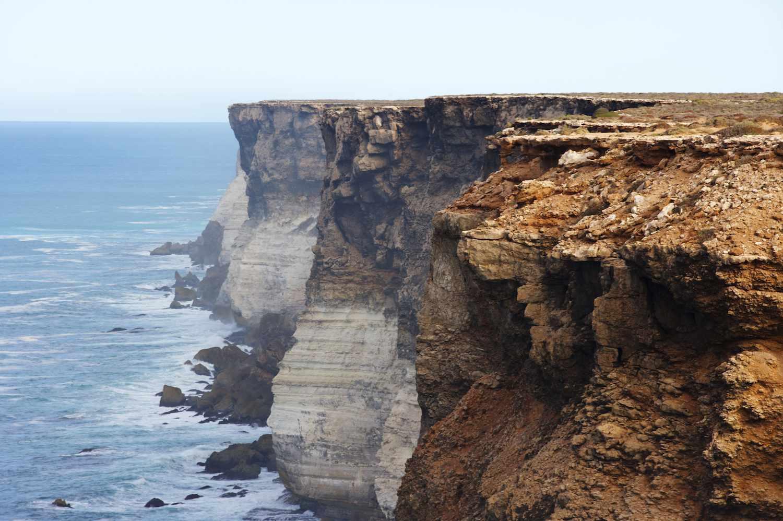 The red and white Bunda Cliffs stretch along the Australian coast